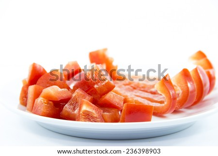 Red bell chili ingredient on white plate - stock photo