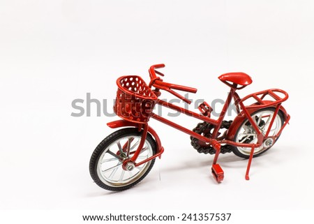 red bicycle toy on white background - stock photo