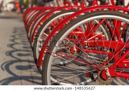 red bicycles parked in the city - stock photo