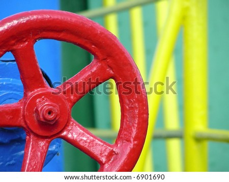 Red big valve of a ship with colorful background - stock photo