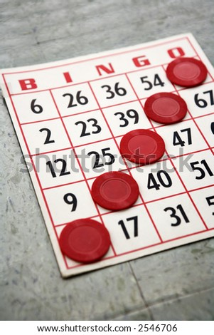Red bingo card with winning chips. - stock photo