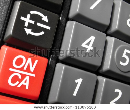 Red,black and grey  calculator buttons closeup - stock photo