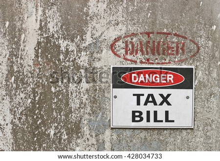 red, black and white Danger, Tax Bill warning sign - stock photo