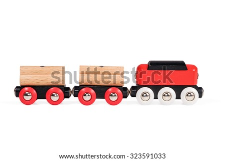 Red black wooden children train on magnets close-up isolated on white background - stock photo