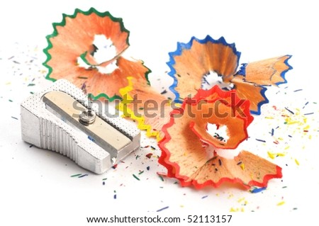 red, blue and green pencil shaving on white background - stock photo