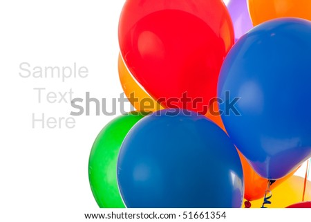 red, blue, green, orange, yellow, and purple balloons on a white background with copy space - stock photo