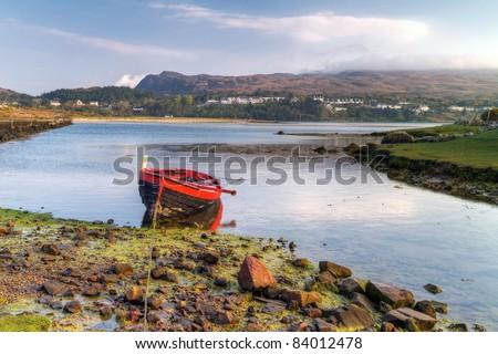 Red boat at Mulranny bay in Irish Co. Mayo - HDR - stock photo