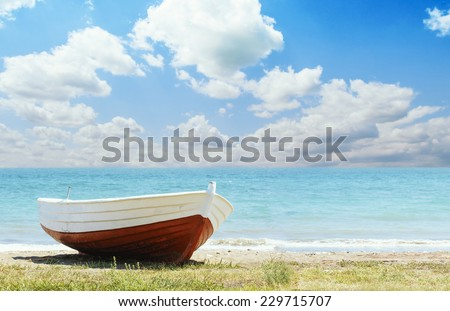 Red Boat on the beach - stock photo