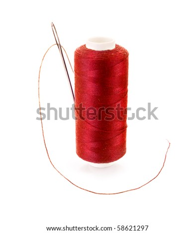 Red Bobbin with needle isolated on white - stock photo