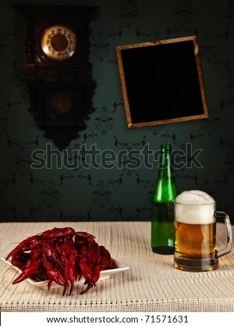 red boiled crawfishes and beer on the table - stock photo