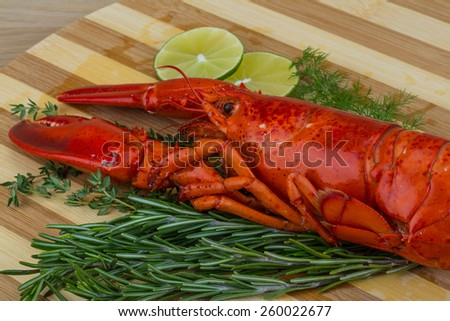 Red boiled lobster with thyme and rosemary - stock photo
