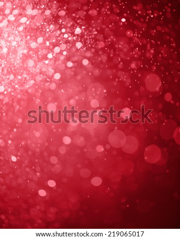 red bokeh background created by christmas lights - stock photo