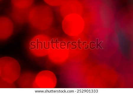 Red bokeh background created by electic christmas lights - stock photo