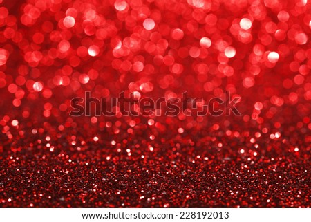 Red bokeh holiday textured glitter background - stock photo