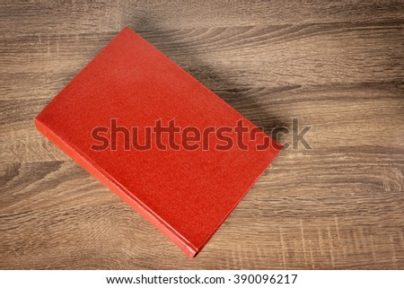 Red book on the table - stock photo
