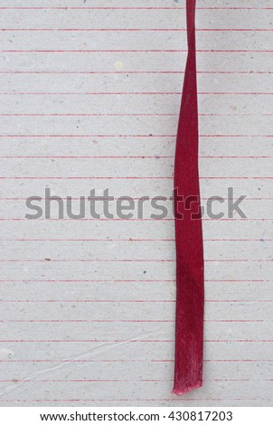 red bookmark on textured paper - vintage paper - text space - stock photo
