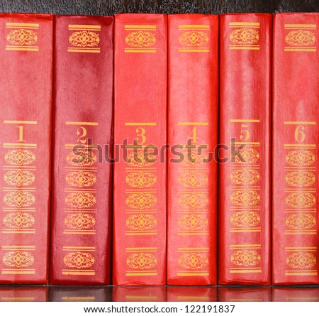 Red books standing in a row - stock photo