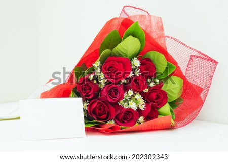 Red bouquet with card - stock photo