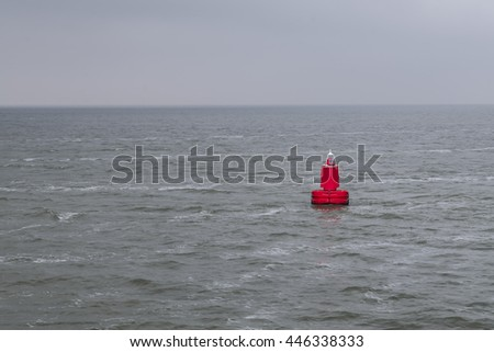 Red bouy floating in sea - stock photo
