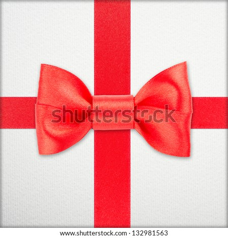 red bow and ribbon over wrapped gift - stock photo