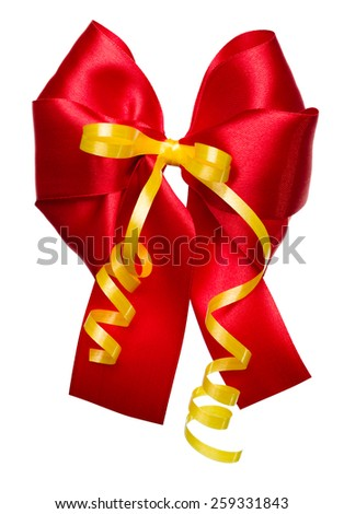 red bow with golden ribbon made from silk isolated - stock photo
