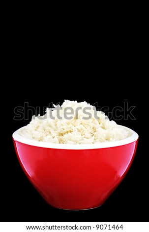 Red bowl of basmati rice, perfectly cooked. Black background. - stock photo