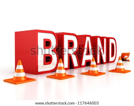 red BRAND text behind the barrier of road safety cones - stock photo