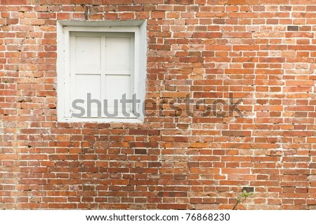red brick and white window - stock photo