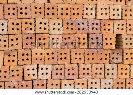 Red brick block for wallpaper and background - stock photo
