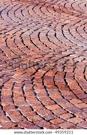 Red brick paved road pattern - stock photo