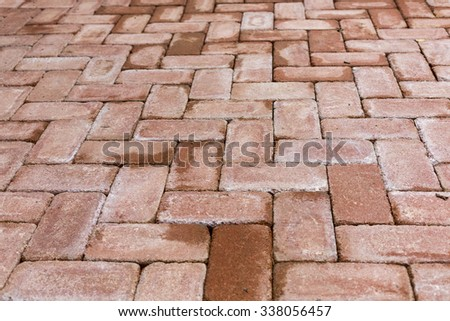 Red brick paving stones on a sidewalk. - stock photo