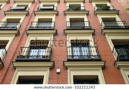 Red brick residential building in Madrid, Spain. - stock photo