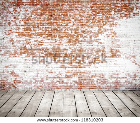 red brick wall and wood floor - stock photo