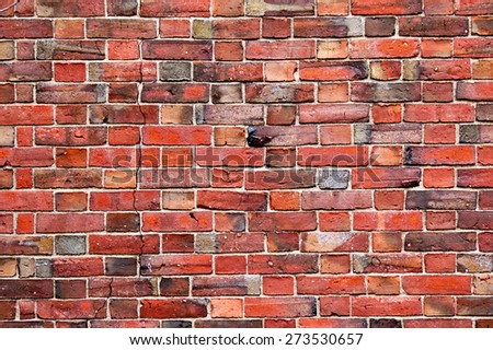 Red brick wall pattern texture backdrop wallpaper - stock photo