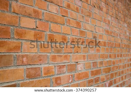 Red brick wall perspective - stock photo