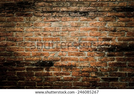 red brick wall texture grunge background with vignetted corners  - stock photo