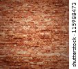 red brick wall texture grunge background with vignetted corners of interior - stock photo