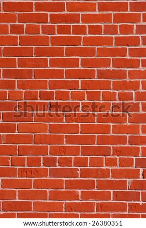 Red brick wall with light cement in between. - stock photo
