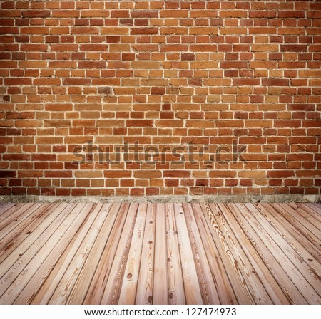 Red brick wall with wooden floor texture interior - stock photo
