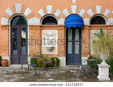 Red Bricked Facade of a Historic Building - stock photo