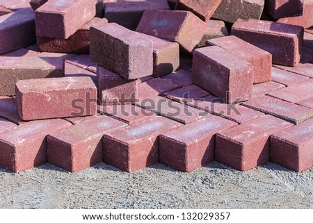 Red bricks on a construction site of a new pavement - stock photo