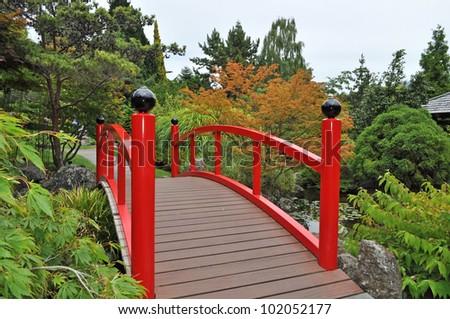 Red bridge in japanese garden - stock photo