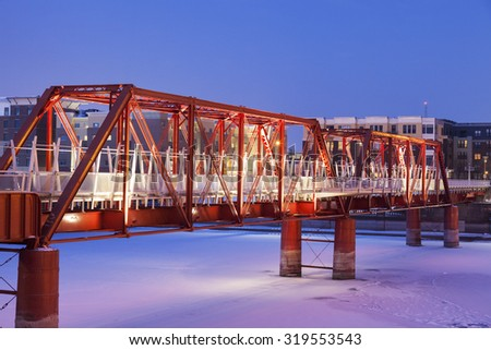 Red bridge in over Des Moines River. Des Moines, Iowa, USA. - stock photo
