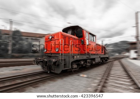 Red bright diesel locomotive with motion blur - stock photo