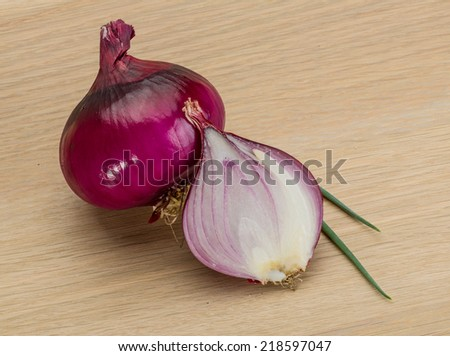 Red bright juicy onion on the desk - stock photo