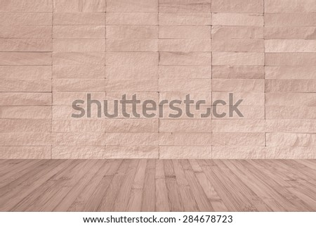 Red brown rock tile wall with wooden floor in red brown color tone for interior background   - stock photo