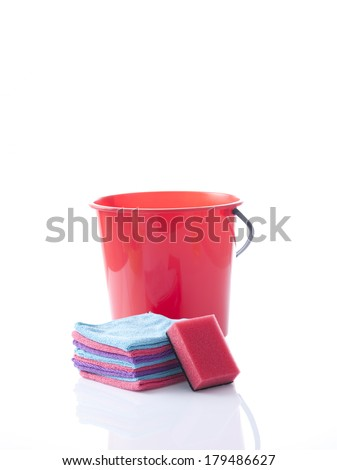 red bucket and cleaning sponge isolated on white - stock photo