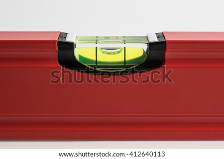red building level, isolated on a white background - stock photo