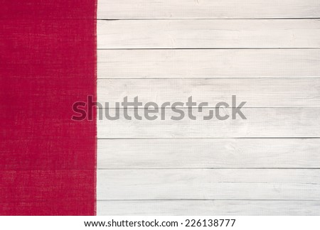 Red Burlap Banner on Side of White Wash Board Background with room or space for copy, text, your words.    Horizontal color photo - stock photo