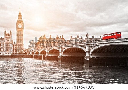 Red bus on Westminster Bridge by the Houses of Parliament - stock photo